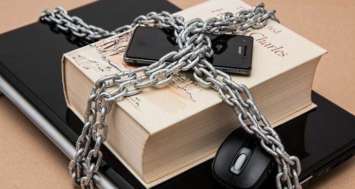 Phone, book, and tablet locked up with a chain